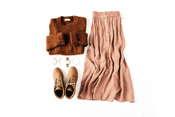 Fashion casual look composition with brown sweater, shoes, skirt, accessories on white background....