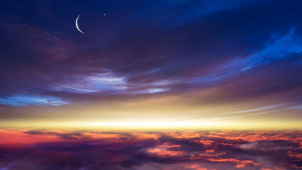 Crescent moon with beautiful sunset background  . Light from sky . Religion background .  Ramadan