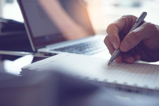 Man hand writing on notebook