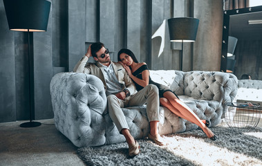 Stylish couple at home Wall mural