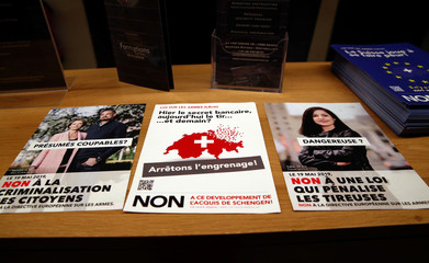 """Leaflets to vote """"no"""" in a May 19 referendum on proposals to tighten weapon ownership laws in line with EU steps are pictured at the Swiss Gun Center in Geneva"""