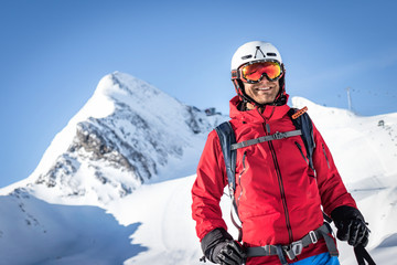 Wall Mural - Portrait of a happy male freeride skier in the alps