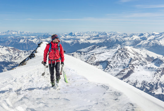 Male touring skier in the mountains