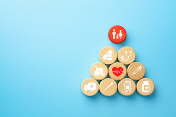 Health insurance concept, wooden blocks with healthcare medical icon, blue background, copy space