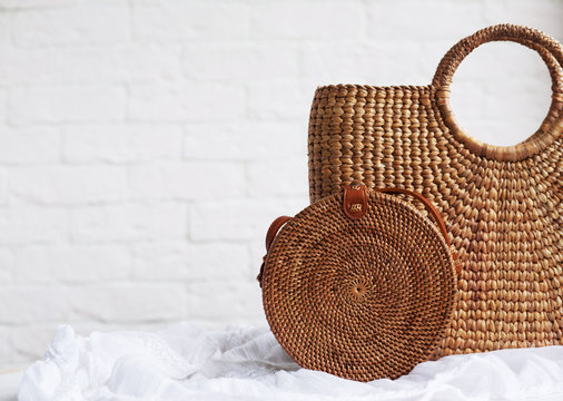 Beautiful and stylish rattan bags on a wooden table. concept