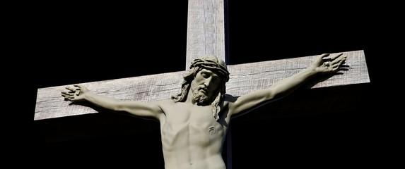 Narrow horizonal top half of crucifix isolated on black Wall mural