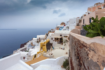 Small view of the fishermen's houses of Oia on rainy day