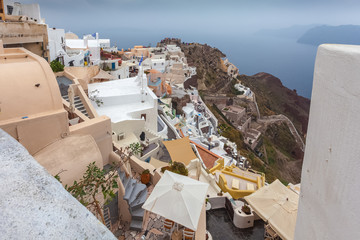 View of byzantine castle ruins and colorful houses of Oia village