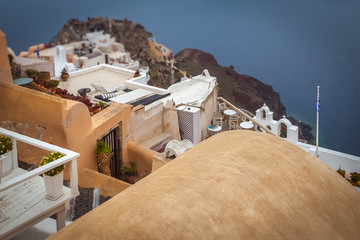 Tilt shift effect of houses and terraces of Oia village on rainy day