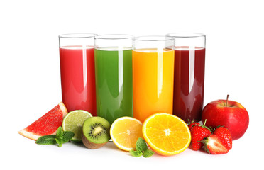 Glasses with different juices and fresh fruits on white background