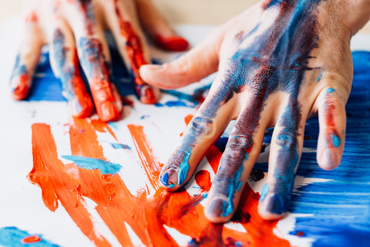 Art therapy. Hobby enjoyment. Man hands in red blue paint. Recreation relaxation. Artist talent creative style technique.