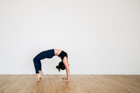 A yoga teacher performing a human arch