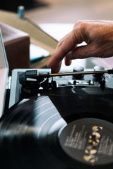 Home: Man Moving Record Player Arm