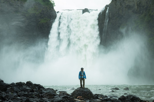 Hiker in front of Thundering Falls