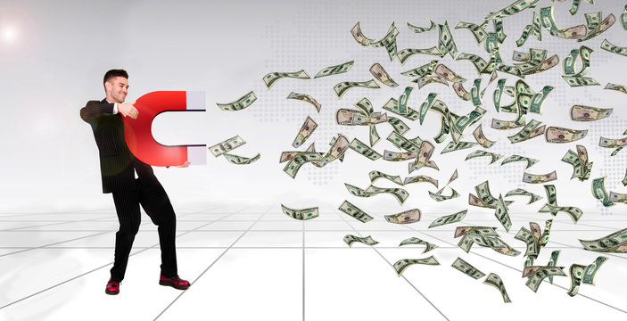 successful man holding horse shoe magnet attract money banknote, business finance wealth concept