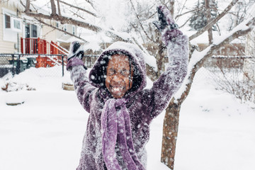 Black girl throwing snow