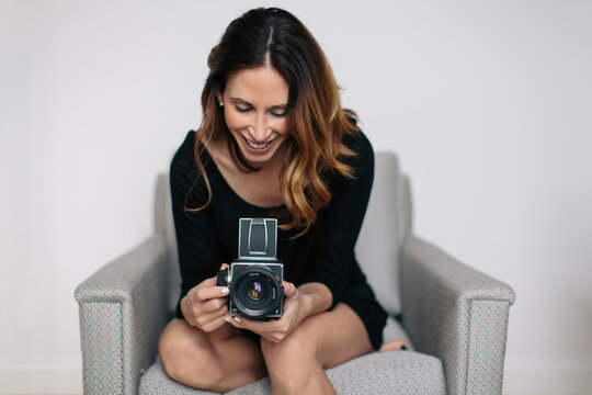 Beautiful woman using a vintage camera