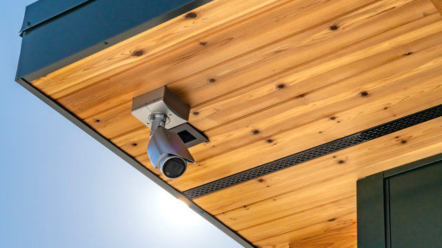 Panorama Home with security camera installed on the wooden underside of its roof