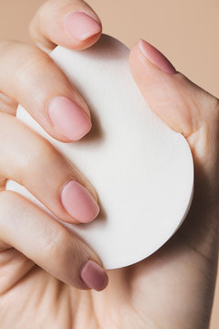 Woman Holding Cosmetic Pads