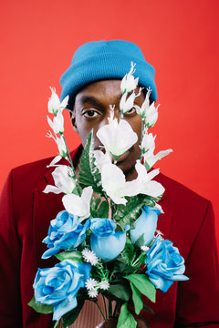 Black man in suit with flowers