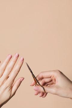Woman Holding Nail Scissors