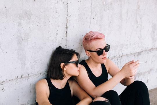 young lesbian couple smoking