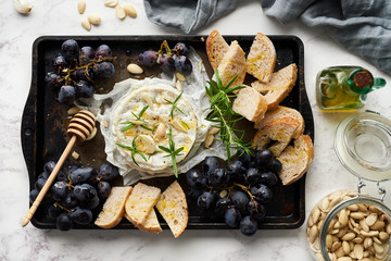 Cheese,grapes and sourdough bread.