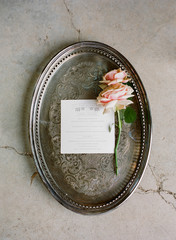 Menu from wedding placed on antique tray