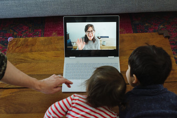 Kids doing video chat with Mom