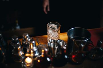 Cocktail preparation in a dark bar