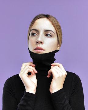 Trendy girl in black turtleneck