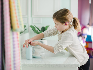 Young girl washing hands