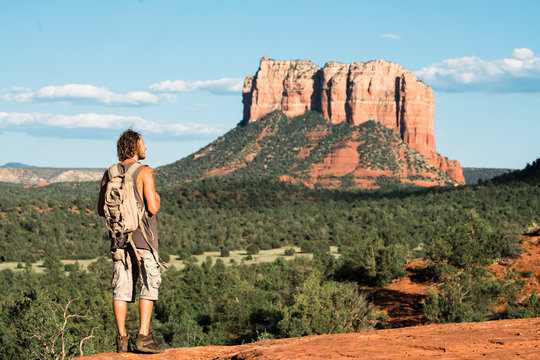 A young man hiking up to Cathedral Rock, Arizona.