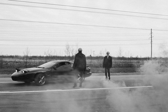 Aliens and a car on the abandoned road