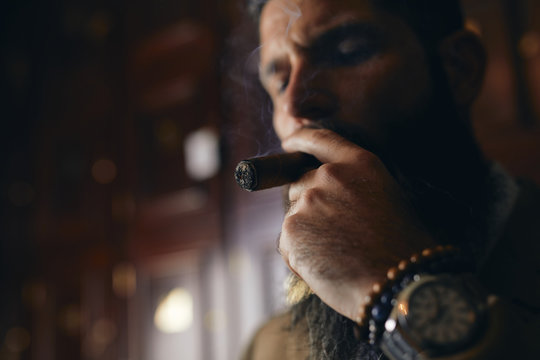 Man enjoying cigar.