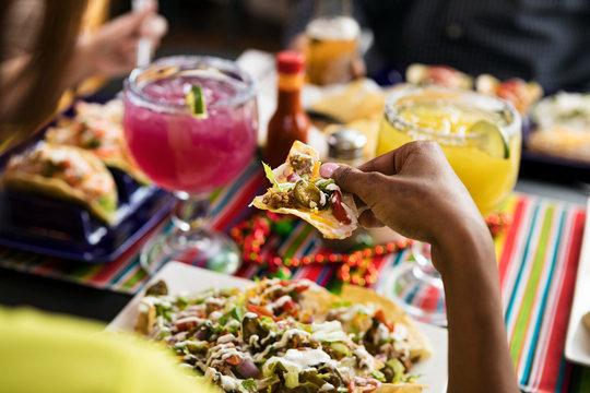 Cinco: Focus On Nachos With Margaritas Behind