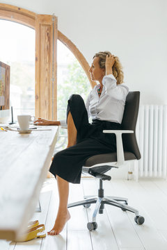 Mature businesswoman working at office.