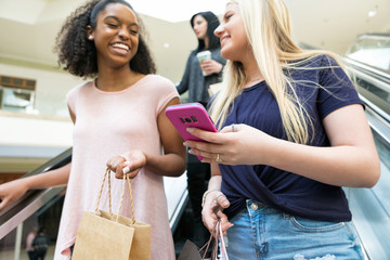 Mall: Girl Friends On Escalator With Cell Phone