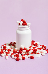 Red And White Medicine Capsule On Purple