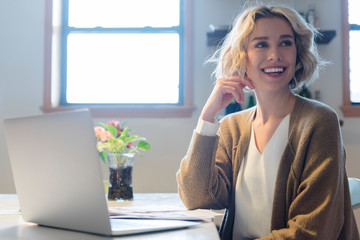 Woman smiling at desk