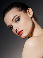 Beauty Editorial Bronze & Gold eyes - Juicy red lips closeup portrait looking at camera.