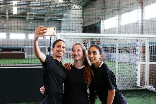Group of friends taking a selfie.
