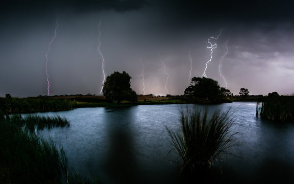 Lightning strikes over water during a wild storm