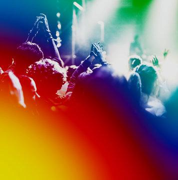 crowd at summer music festival - rainbow colors - lgbt, diversity concept