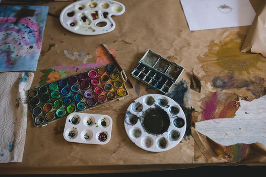 Watercolor supplies on a table