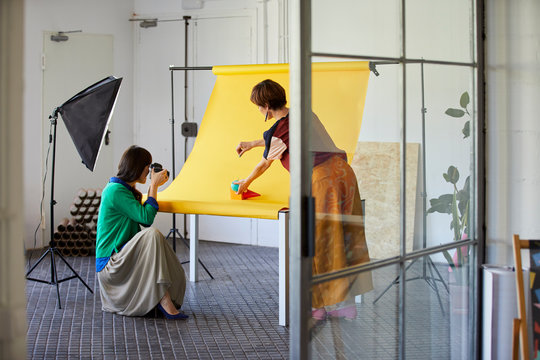Professional With Colleague Photographing Objects