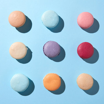 Pattern of multi-colored macaroons on a blue background
