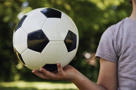 Child holding a football