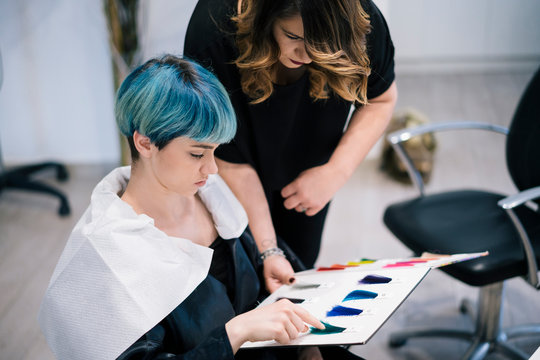 Young Woman dyeing her hair at a Salon