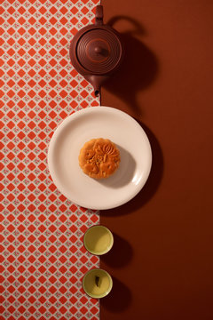 Overhead view of mooncake with tea on table